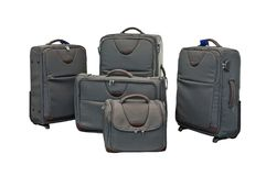 Travel luggage set with airplane in background Royalty Free Stock Photography