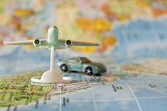 Travel luxury car and jet airliner Stock Photos