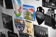 Travel magnets. Black and white and colored magnets royalty free stock image