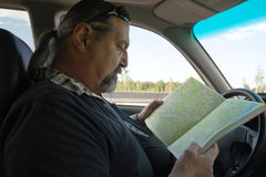 Travel - man in a car with a map stock images