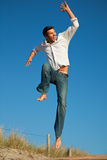 Travel man jumping happy to vacation Stock Image