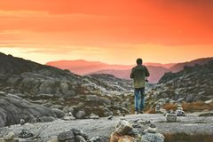 Travel Man walking enjoying sunset mountains Stock Photos