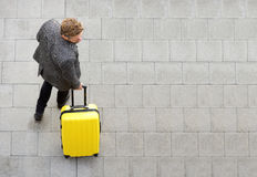 Travel man walking with suitcase Royalty Free Stock Images