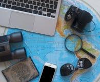 Travel map laptop computer keyboard personalized Russian glasses passport photo camera binoculars flat lei phone phone mobile stock photography