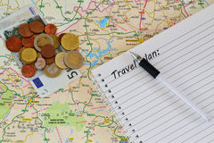 Travel map, notebook and money Royalty Free Stock Image