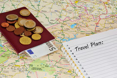 Travel map, notebook and money Stock Photos