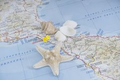 Travel map with pin and sea shell, concept. Image of Travel map with pin and sea shell, concept Stock Photography
