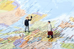 Travel meeting. Travel in work on mini map Royalty Free Stock Photography