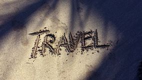 Travel Message in Sand with Palm Tree Shadows. Travel message handwritten in smooth sand with palm shadows in tropical sunlight stock footage