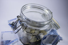 Travel money glass jar world vacation planning currency Royalty Free Stock Photo