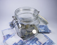 Travel money glass jar world vacation planning currency Royalty Free Stock Image