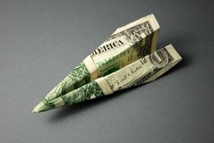 Travel Money (US Dollars). A paper plane made from an American $1 bill stock image