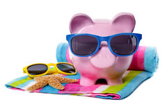 Travel money, vacation savings concept, Piggy Bank on beach Royalty Free Stock Photo