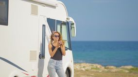 Travel in motorhome. Traveling woman by mobile motor home RV campervan. Woman drinking coffee. Travel in motorhome. Traveling woman by mobile motor home RV stock video footage