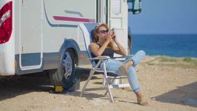 Travel in motorhome. Traveling woman by mobile motor home RV campervan. Woman drinking coffee. Travel in motorhome. Traveling woman by mobile motor home RV stock video