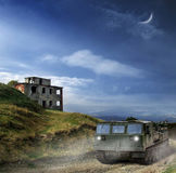 Travel through mountains. Large caterpillar rover runs through mountain wilderness Royalty Free Stock Photography