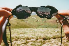 Travel mountains through sunglasses vision conceptual landscape. Summer vacations lifestyle outdoor Stock Photography