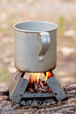 Travel mug on fire Royalty Free Stock Photos