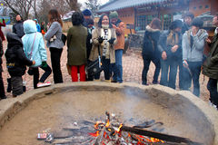 Travel in Naminara republic, Korea. NAMINARA REPUBLIC, KOREA - NOVEMBER 26 : The unidentified group of tourists are standing around fireplace on November 26 royalty free stock photography