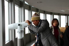 Travel in Namsan Seoul Tower, Korea. CENTRAL SEOUL, KOREA - NOVEMBER 27 : The unidentified man is seeing view on November 27, 2011 at Namsan Seoul Tower, Central royalty free stock photo