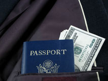 Travel needs. Dollars and passport as travel needs Stock Images