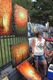 Travel-New Orleans-Artist in French Quarter. Travel-Louisiana, New Orleans, French Quarter, Artist at Jackson Square and her Artwork Stock Photo