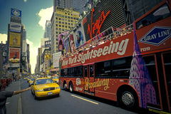 Travel in New York. Tour bus and tourists in Times square Royalty Free Stock Photos