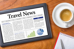 Travel News. Tablet on a desk - Travel News Royalty Free Stock Photography