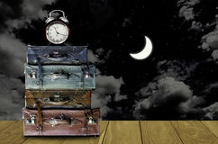 Travel at night concept, Vintage travel bag with moon in night. Timt to travel at night concept, Vintage travel bag with moon in night sky background Royalty Free Stock Photo
