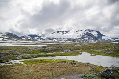 Travel in Norway mountains at summer. Hiking in dramatic weather in Europe nature reserve Royalty Free Stock Photography