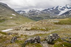 Travel in Norway mountains at summer. Hiking in dramatic weather in Europe nature reserve Stock Images
