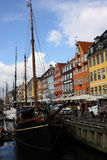 Travel in Nyhavn of Denmark. Travel in Nyhavn Port of Denmark in Spring. The weather is great with some cloud. You can find many ships and restaurants in this Royalty Free Stock Images