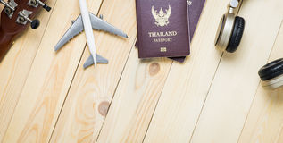 Travel objects equipments on wooden table with copy space. Stock Images
