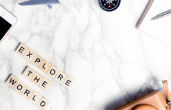 Travel objects with explore the world text on marble Stock Photography