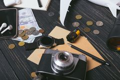 Travel objects flatlay on white wooden with copy space. Money, camera, phone, plane, and other staff royalty free stock images