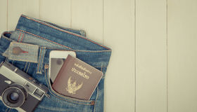 Travel objects in hipster jeans pocket. Copy space Royalty Free Stock Images