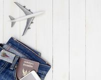 Travel objects in Hipster jeans pocket on white wooden. Copy space Royalty Free Stock Photos