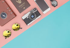 Travel objects on pink with blue pastel Stock Photos
