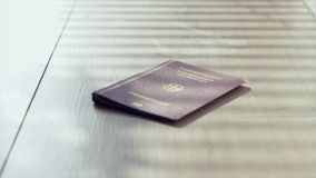 Travel Passport background concept footage. The european German Passport on a wooden desktop stock video