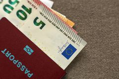Travel passport and money, Euro banknotes bills on copy space background, top view. Traveling and finance problems concept.  royalty free stock photos