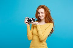Travel and People Concept - Headshot Portrait of happy ginger red hair girl ready to travel with vintage camera in happy. Travel and People Concept - Headshot Royalty Free Stock Photography