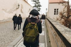 Travel persone with backpack walking in europe. City Stock Image