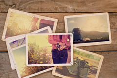 Travel photo album on wood table Royalty Free Stock Images