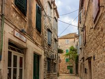 Big stone houses on the street in Hvar, Croatia. royalty free stock image