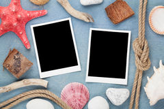 Travel photo frames on blue wooden texture Stock Photos
