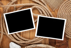 Travel photo frames on wooden texture. With burlap and rope around stock photo