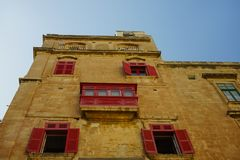 Travel photo of the narrow streets in the old city of Valletta. In Malta with colourful balconies Stock Photo