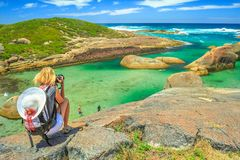 Travel photographer in Australia. Travel photographer takes shot of Elephant Rocks in William Bay National Park near Denmark, Western Australia. Female tourist royalty free stock photos