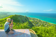 Travel photographer in Hawaii. Travel photographer takes shot of Lanikai Beach and Kailua Beach in Oahu East shore, Hawaii, USA. Nature photographer taking stock photo