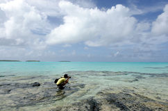 Travel photographer photographing Aitutaki Lagoon Cook Islands Stock Photography